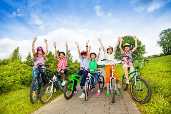 excited-kids-helmets-bikes-hands-up-sitting-their-air-43447134.jpg