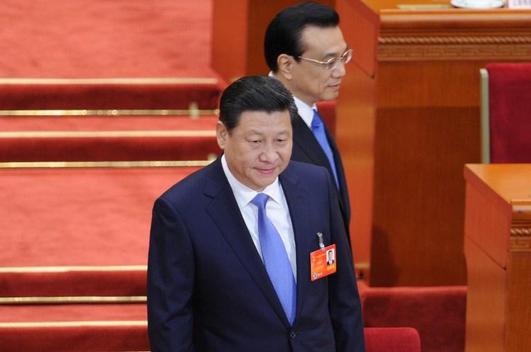图片:习近平和李克强在十二届全国人大会议会场上。(法新社)