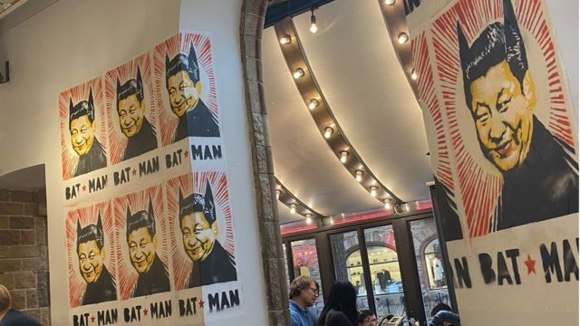 Posters showing Chinese leader Xi Jinping wearing bat ears