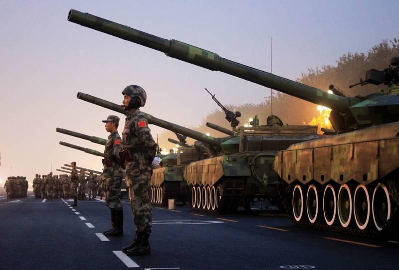 前解放軍中校姚誠認為,中共堅持不肯放下武器,要14億人一起死,是因為知道自己手上血債纍纍,「退下來以後,老百姓要找他算帳的」。(法新社檔案照)