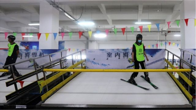 Employees demonstrate indoor ski machines at Zhangjiakou Ice and Snow Sports Equipment Industrial Park, during an organised media tour to venues of the Beijing 2022 Winter Olympic Games in Zhangjiakou, Hebei province, China July 15, 2021.