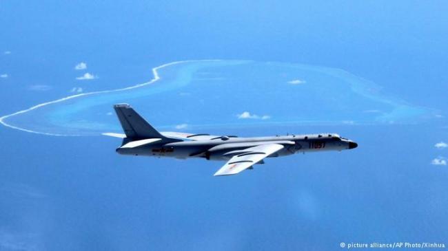 中国空军远海测实力 日本政府誓言捍主权