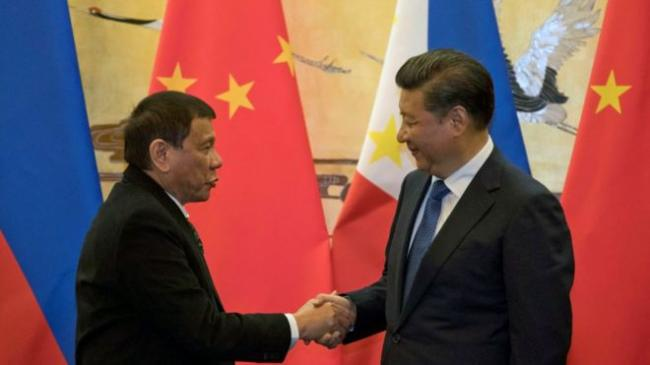 161020071050_china_philippines_leaders_976x549_reuters_nocredit.jpg