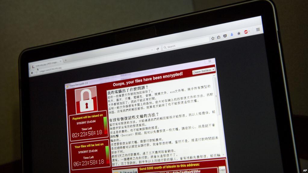 """在台湾受到勒索软件感染的一台电脑屏幕上出现的信息:""""哎哟,你的文件被加密了!""""黑客索要价值300美元的比特币,这是一种匿名的网络货币。"""