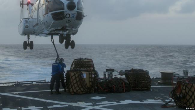 美军驱逐舰在中国南海开始闯岛礁行动