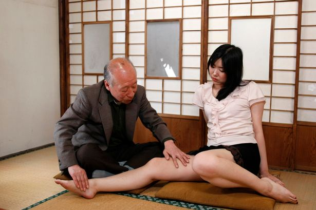 Pornographic-movie-actor-Shigeo-Tokuda-performs-with-actress-Yuri-Kuroda-during-the-shooting-of-his.jpg