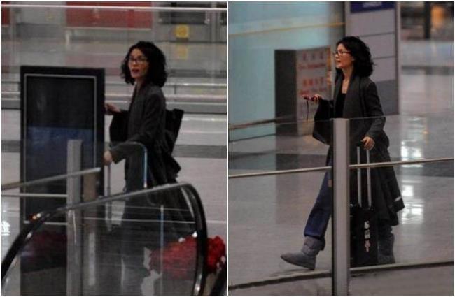 低调王菲在机场大喊   四处找谢霆锋