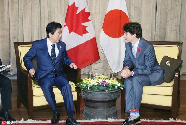 尴尬:加拿大总理不肯来签TPP,安倍散会…
