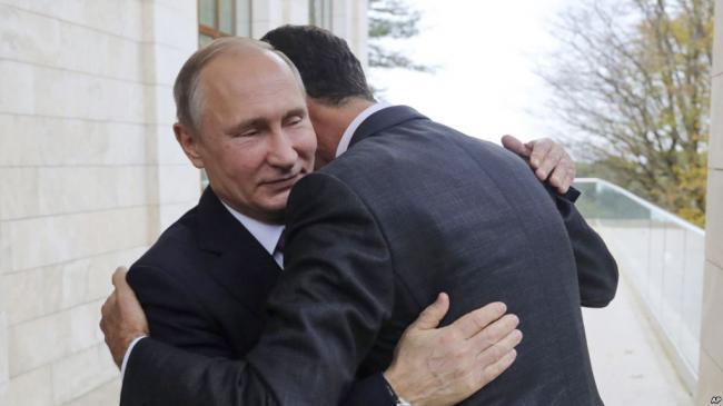普京到访叙利亚并宣布撤军