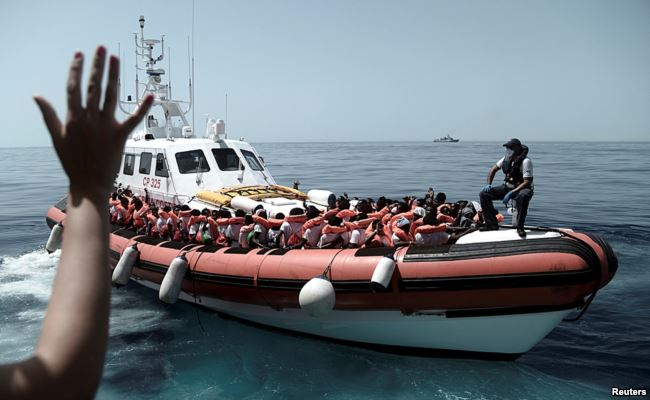 西班牙热烈欢迎630非洲移民