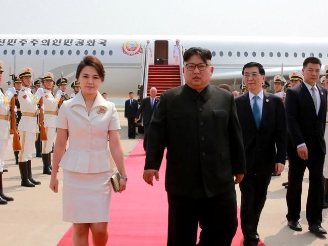 金正恩此次访华   王沪宁前往机场接机