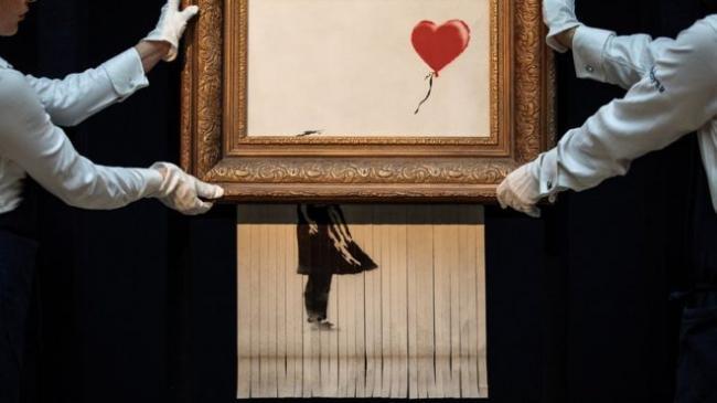 苏富比拍卖现场班克斯名画自毁背后真相