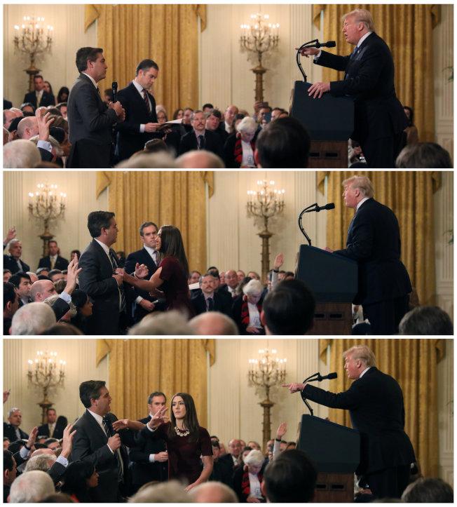 川普总统与CNN记者阿科斯塔发生争执(上),白宫助理上前欲取回阿科斯塔手中麦克风(中),阿科斯拒绝交出,白宫助理伸手要拿麦克风(下)。 (路透)