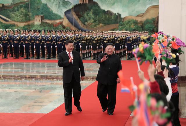 新华社公布习近平周二在北京人民大会堂迎接金正恩的相关照片。新华社