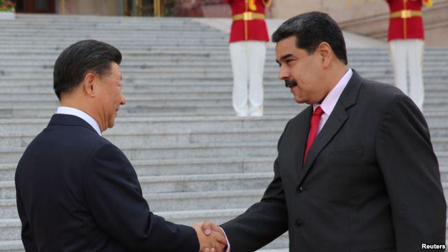 中国国家主席习近平2018年9月14日在北京欢迎到访的委内瑞拉总统马杜罗。