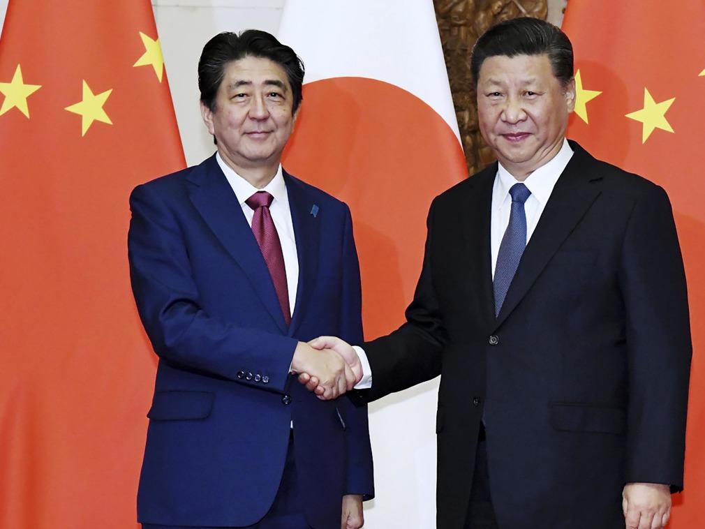 习近平访日前 王毅忽然接到日本外相的电话