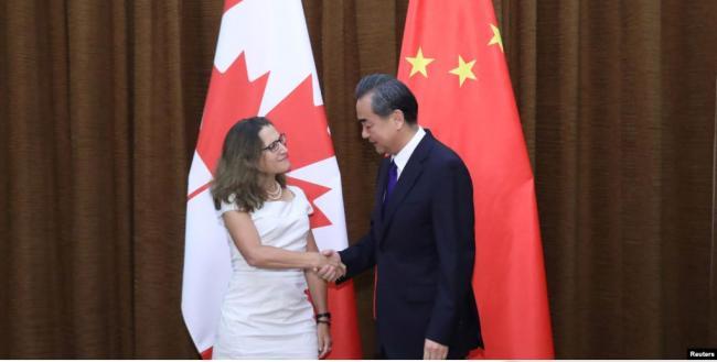 放不放孟晚舟?王毅和加拿大外长正式会谈