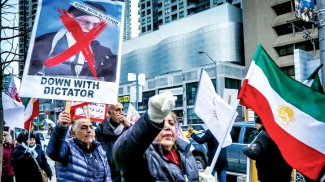 """不怕定为""""伊奸""""?伊朗裔多伦多集会支持美国"""