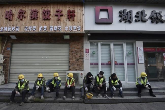 为复工铺路?中国6省下调疫情警报 反常迟报疫情